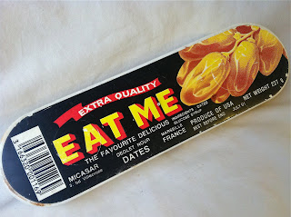 A box of dates labeled Eat Me