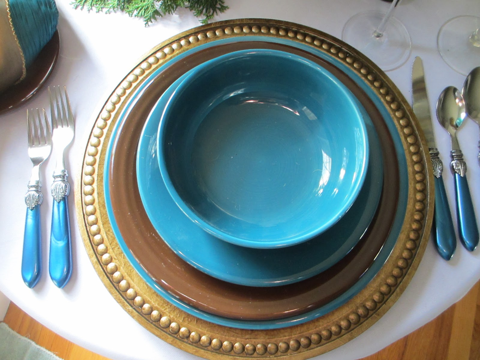 The dinner plate and bread/butter plate are  Chocolate  Fiesta from Homer Laughlin & Table for One: Chocolate Brown and Blue Santa Table