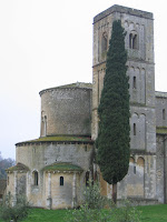 Montalcino's Sant'Antimo abbbey: bell tower and cypress tree