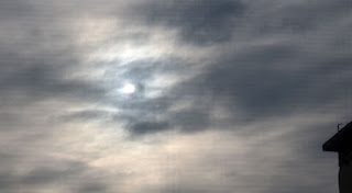 The sun attempting to break through the clouds