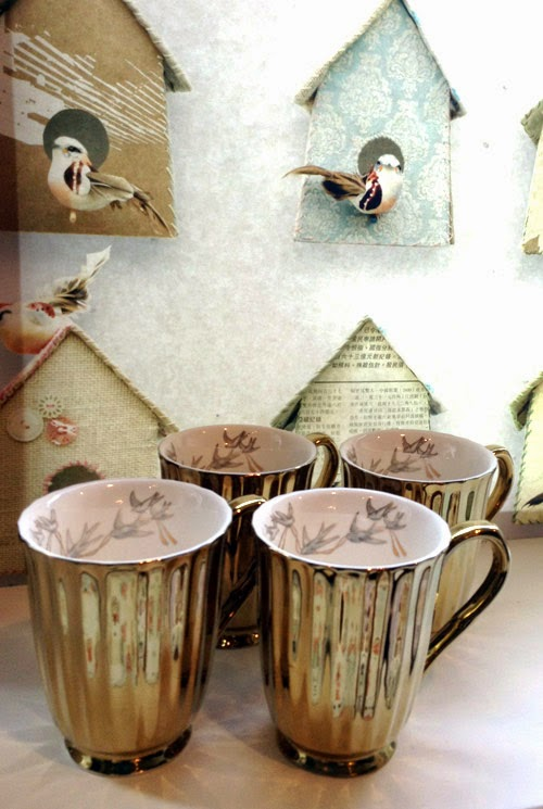 http://www.pierrotetcoco.com/set-of-4-gold-hirondelle-mugs/