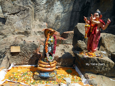 Lord Shiva with His Son Ganesha in the Jogeshwari caves courtyard in Mumbai