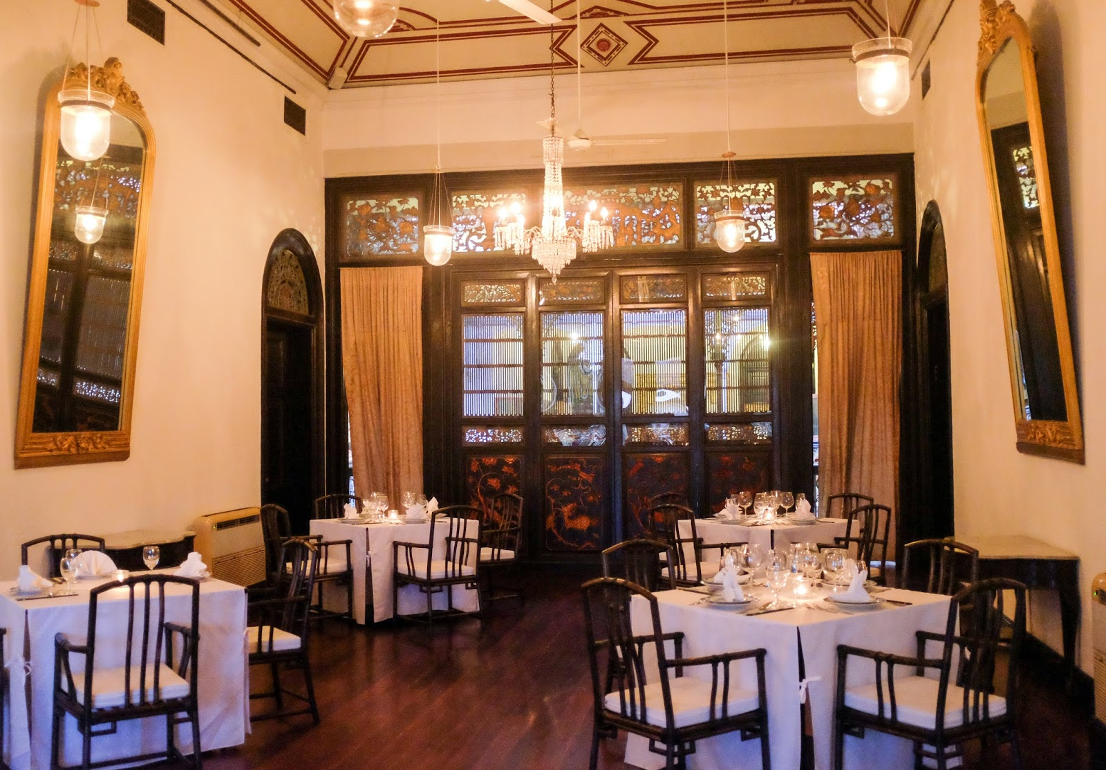 this much respected restaurant serves modern cantonese cuisine in the blue mansion a penang boutique hotel with an indigo blue facade and a lavish interior