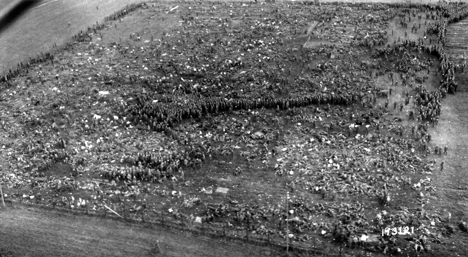 Just some of the tens of thousands of POW's captured after the collapse of the Faliase Pocket are seen from the air Nonant le Pin POW camp.