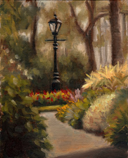 Oil painting of a Victorian-style black lamp post surrounded by flowers and trees with a path leading towards.