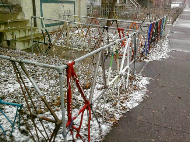 Creative fences made out from old waste bicycle parts for Out of waste material