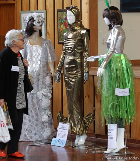 Margaret Wilson, Havelock North, looking at top entries from the Central Hawke's Bay Business and Professional Women Harvey World Travel Wearable Creations competition, in The Centralines Art Extravaganza Hall, at Central Hawke's Bay The Festival '15, at Pukeora Estate, south of Waipukurau. photograph