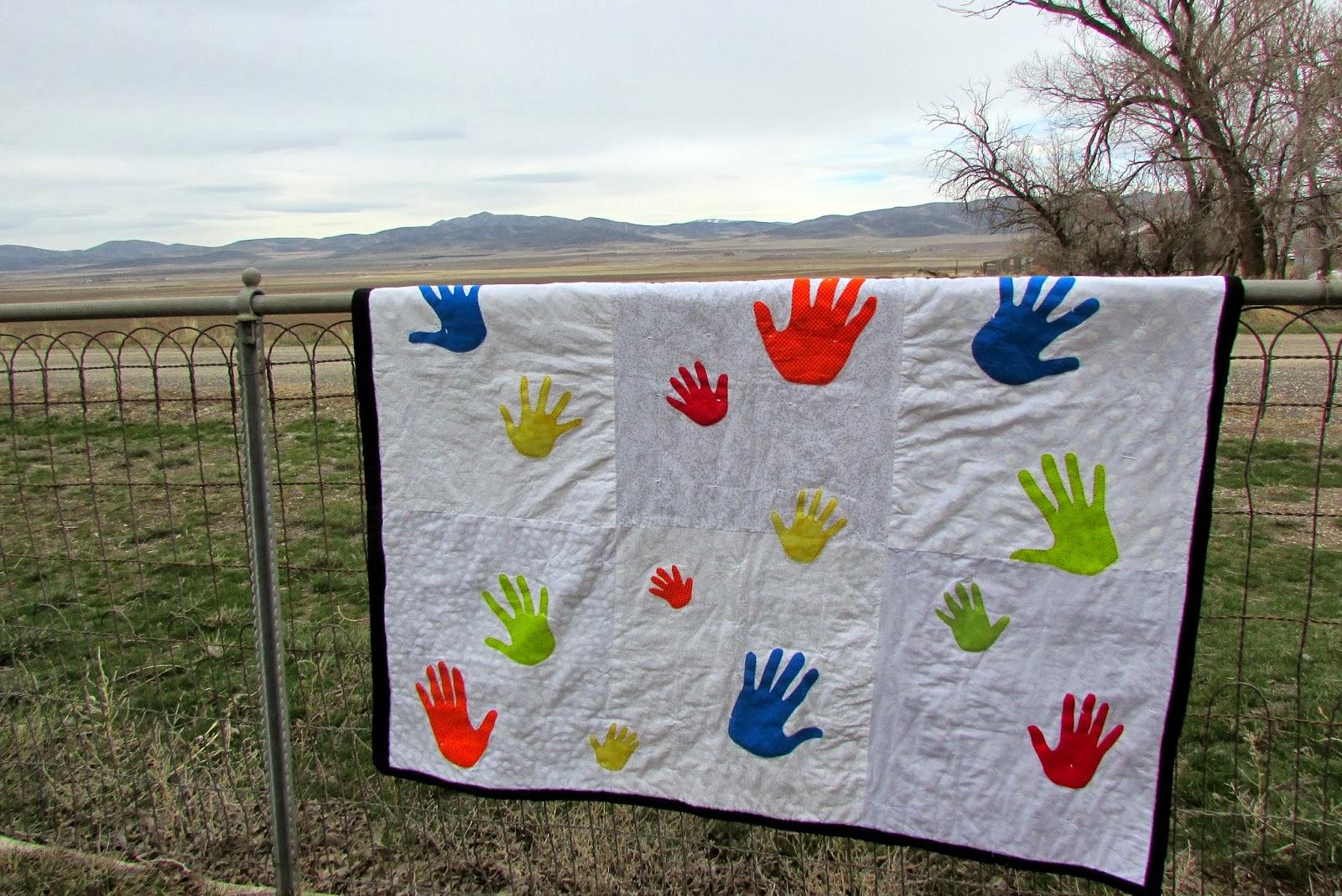 A lively hope handprint quilt