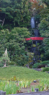 View of red bridge and waterfall at Fujita Memorial Gardens