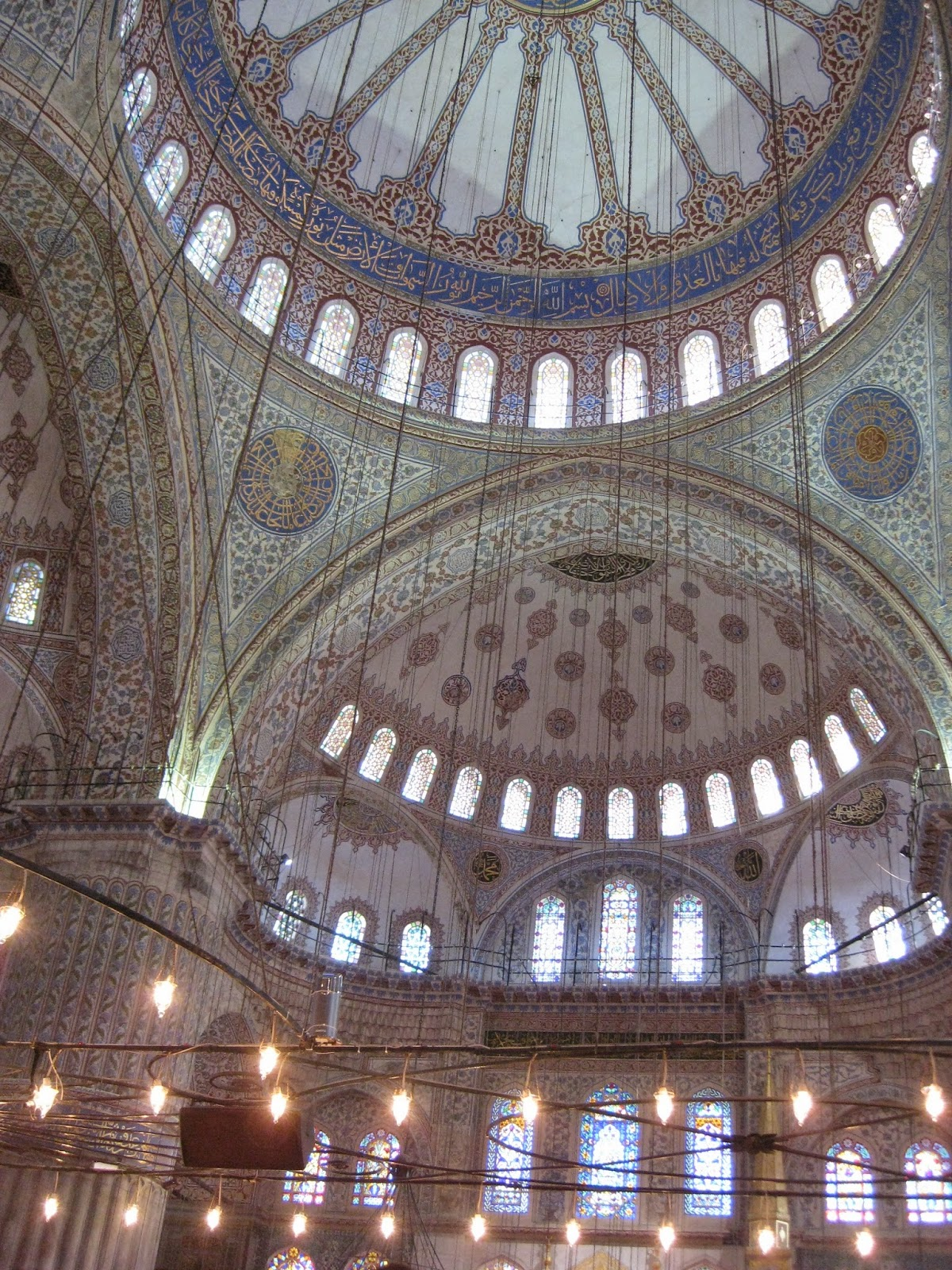 Istanbul - The ceiling and lights inside the Blue Mosque are amazing