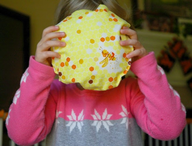 child holding sun sewing project