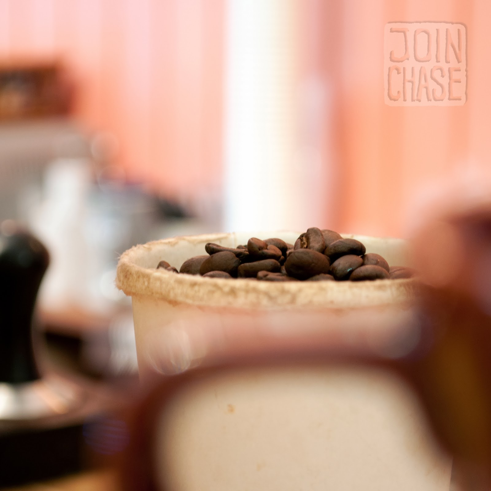 "A cup of freshly roasted beans ready to be ground up and served in a delicious latte from ""Coffee by Daniel"" in Ochang, South Korea."