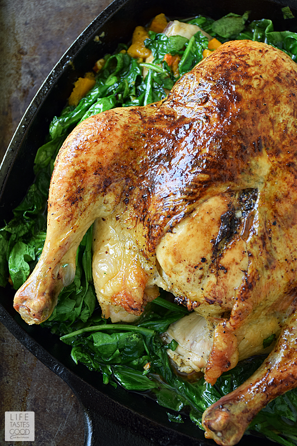 Whole Roasted Chicken with Vegetables | by Life Tastes Good is a comforting meal perfect for the fall season. In addition to the roasted chicken, this complete dinner also incorporates my favorite fall flavor, butternut squash, and Popeye's favorite veg, nutrient rich spinach all cooked together in one skillet. #LTGRecipes #SundaySupper