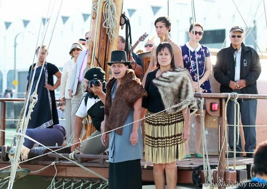 Erina Bryant-Toi, Ahuriri, (in the hat) performs the karanga, during the powhiri (welcome) for Te Matau A Maui, a double hulled sailing waka, one of the first events in Art Deco Week celebrations, at the Napier Sailing Club photograph