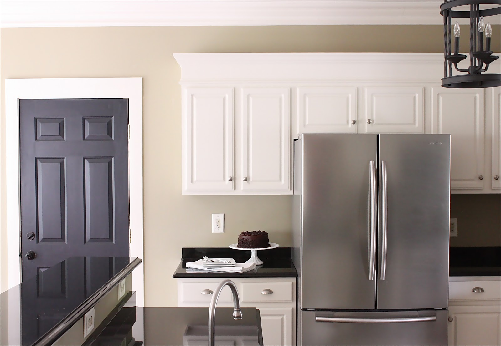 The yellow cape cod painting kitchen cabinets painted for Kitchen wall colors with black cabinets