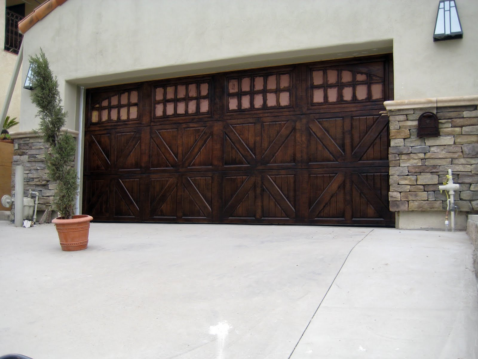 Faux wood doors love paper paint for Faux painted garage doors