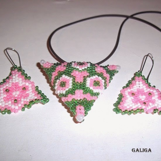 necklace with a triangular pendant with beads