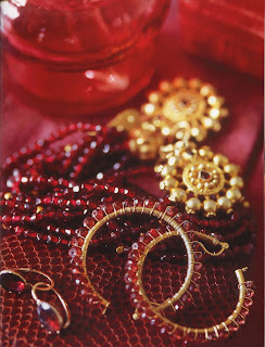 Various aspects of the garnet were used for earrings in nineteenth-century France and Italy, such as these hoops made in India and this multistrand necklace of faceted Stones that look like pomegranate seeds.