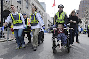 . injured by one of two bombs exploded during the 117th Boston Marathon .