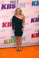 Britney Spears posing for cameras in a black dress