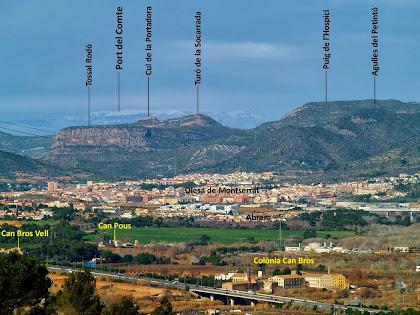 Panoràmica, vers el nord-oest, d'Olesa de Montserrat amb les muntanyes del Tossal Rodó, el Cul de la Portadora, el Turó de la Socarrada i el Puig de l'Hospici