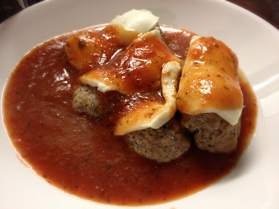 meatballs in tomato sauce with mozzarella