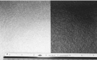 Photograph of nonwoven geotextiles. The geotextile on the left has no ultravi- olet protection, while the geotextile on the right has ultraviolet protection.
