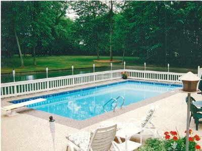 Residential and commercial swimming pool pool deck for Swimming pool resurfacing