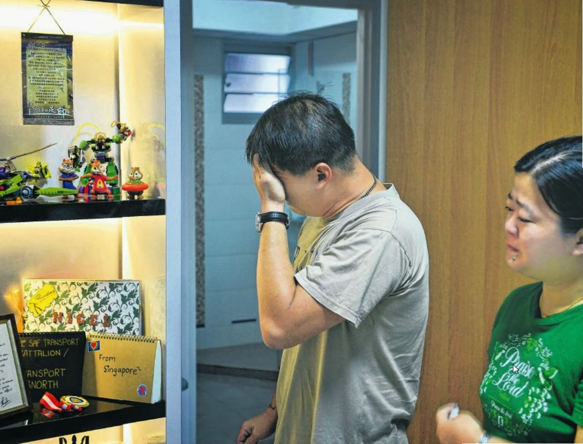 Mr Yap and Madam Ang with their children's favourite toys at their new flat. The driver of the truck which knocked their two boys down was sentenced to two weeks' jail and banned from driving for five years.