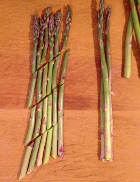 Asparagus shown cut on the diagonal before cooking
