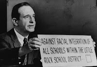 Arkansas Governor Orval Faubus 1957, refuses to desegregate Little Rock schools holding up sign