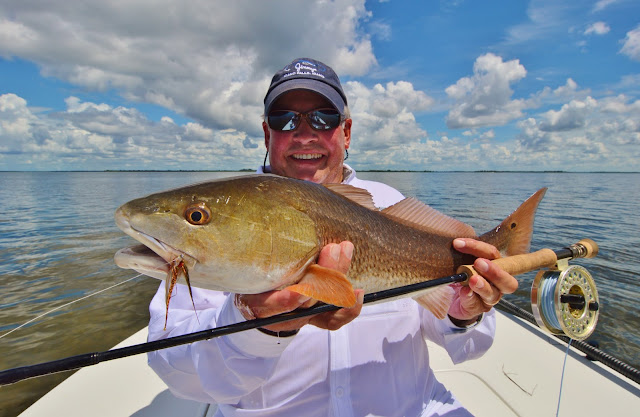 Pine Island fishing at it's best with a beautiful Redfish on Fly from the Matlacha Pass