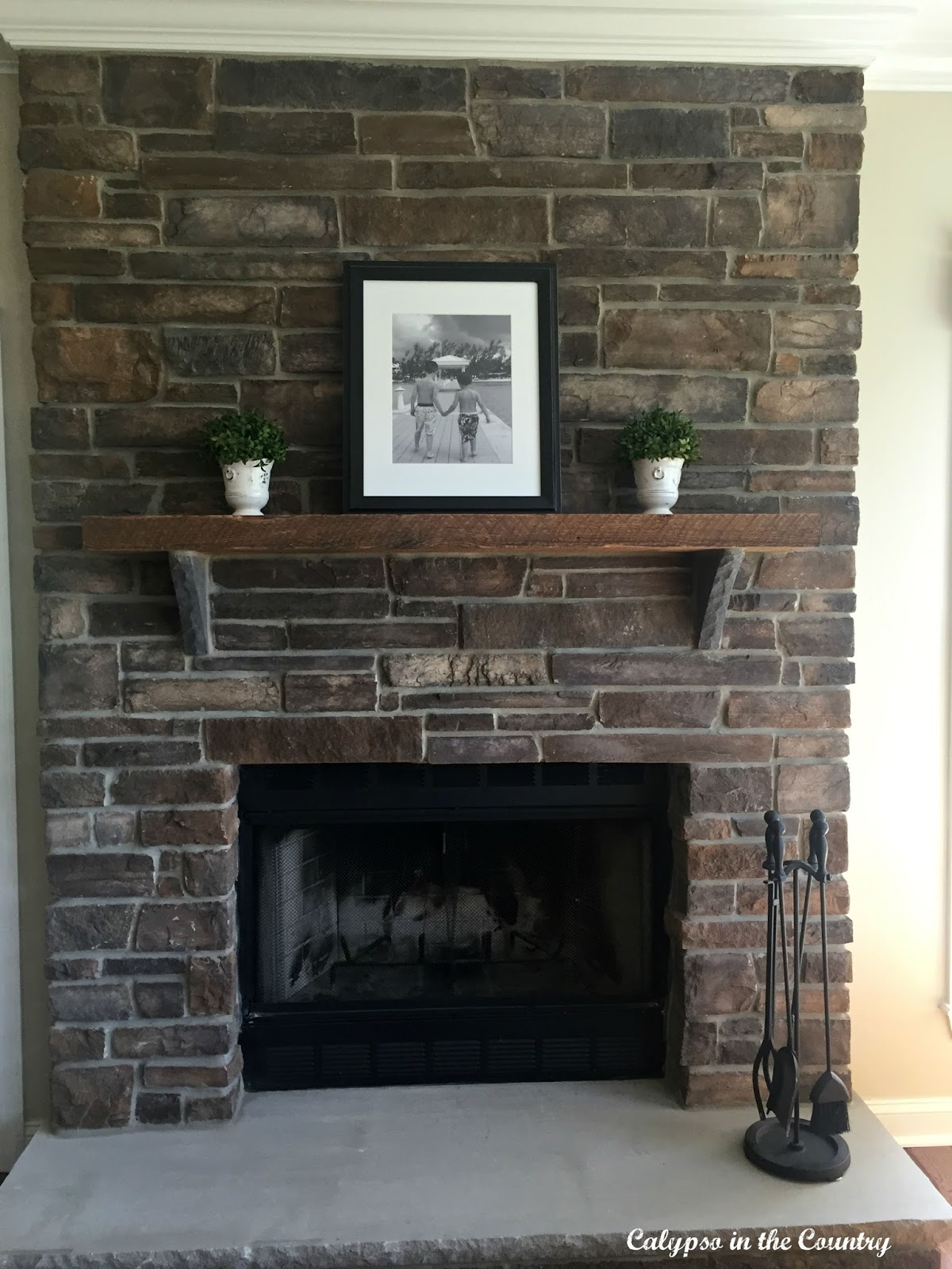 Rustic stone fireplace calypso in the country for Rustic stone fireplace