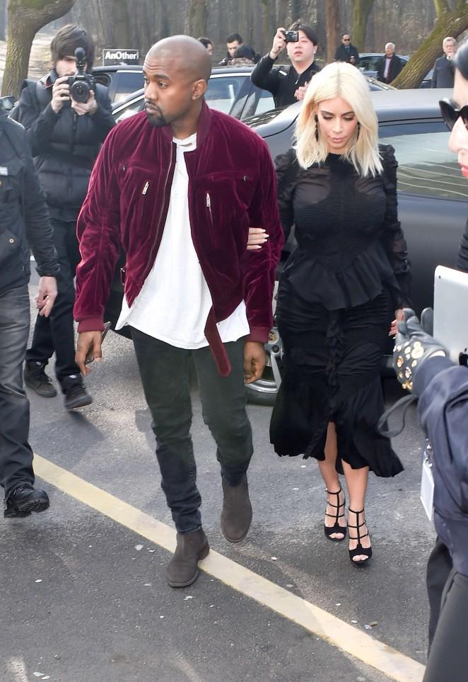 Kim Kardashian and Kanye West attend the Louis Vuitton Fall/Winter 2015 Paris Fashion Week Show