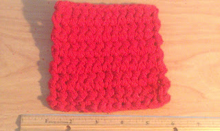 crocheted red coaster