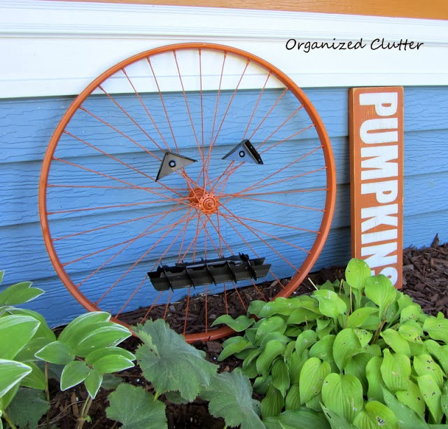 Bicycle Wheel Pumpkin www.organizedclutterqueen.blogspot.com