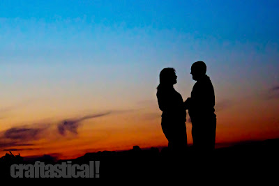 people silhouetted in front of a setting sun