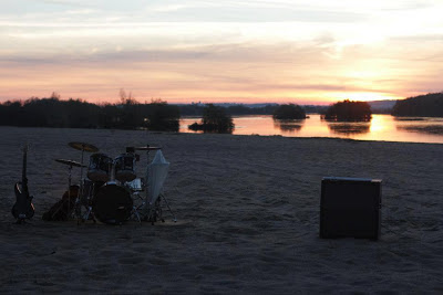 View of tagus river with musical instruments on the sand