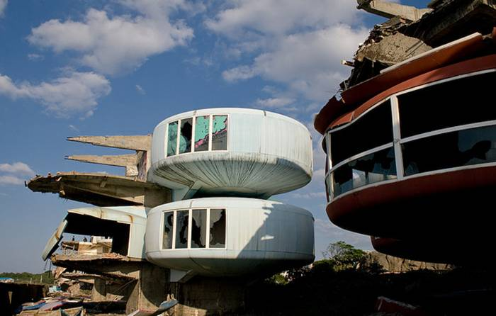 Sanzhi UFO houses, also known as the Sanzhi pod houses or Sanzhi Pod City, were a set of abandoned pod-shaped buildings in Sanzhi District, New Taipei City, Taiwan. The buildings resembled Futuro houses, some examples of which can be found elsewhere in Taiwan. The site where the buildings were located was owned by Hung Kuo Group.