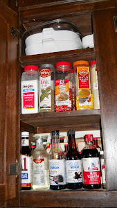 Upper left end spice cupboard