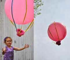 girl letting balloon go