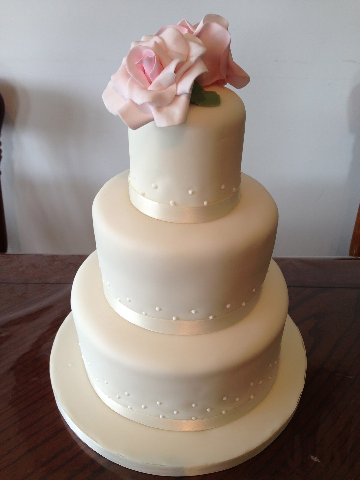 Eggless Bakes 3 tier wedding cake with pink roses