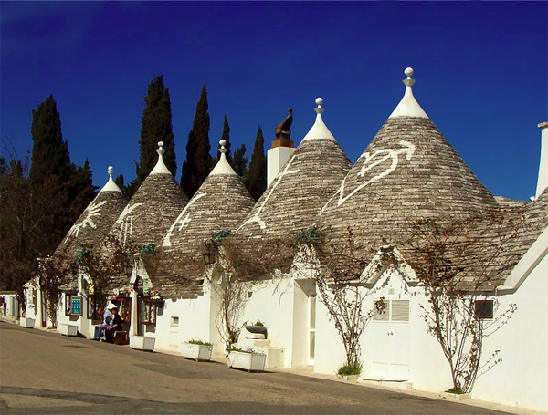 Row of trullo houses in Monte Pertica street in Alberobello,