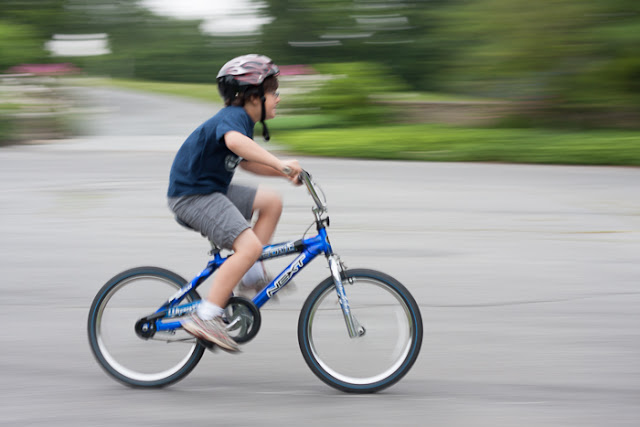 boy riding a bike with blurred background