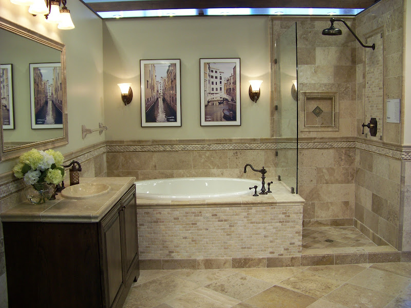 of travertine tiles gives this bathroom an earthy natural look title=