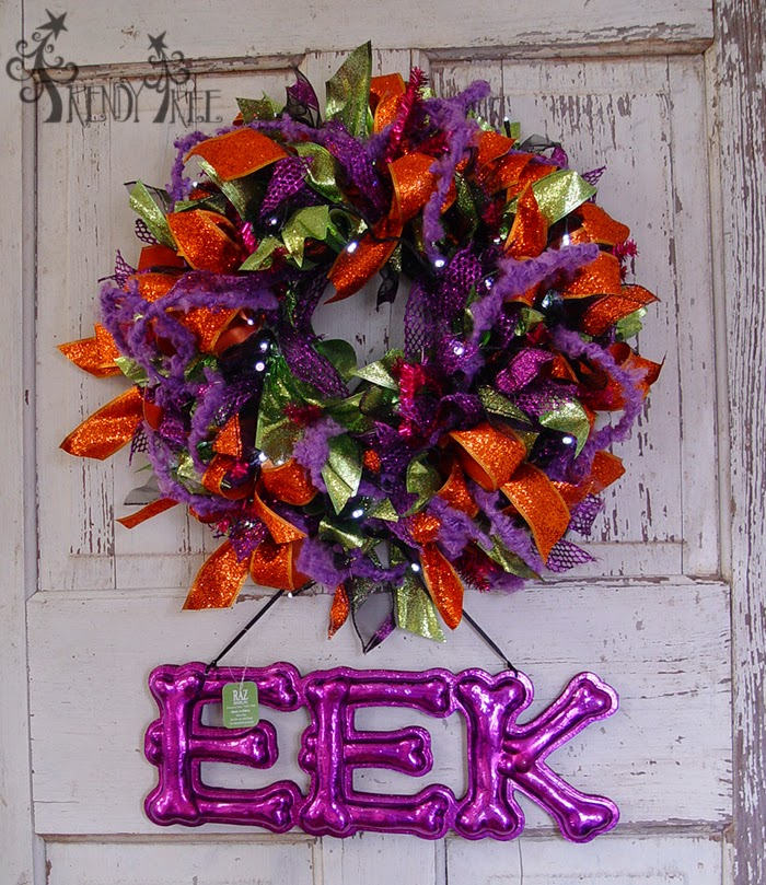 http://www.trendytree.com/raz-christmas-and-halloween-decor/raz-14-bony-eek-and-boo-halloween-sign-assorted.html