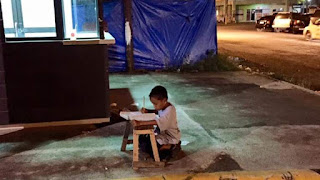 http://news.sky.com/story/1515921/boy-does-homework-by-the-light-of-mcdonalds