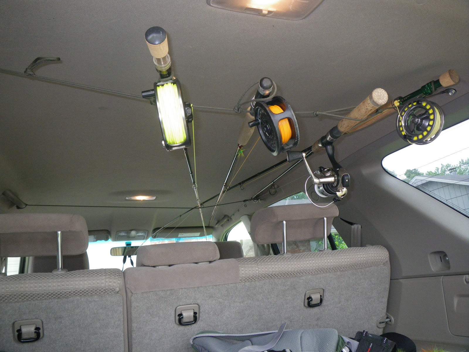 Fly in the south diy redneck rodrack for your suv for Suv fishing rod holder
