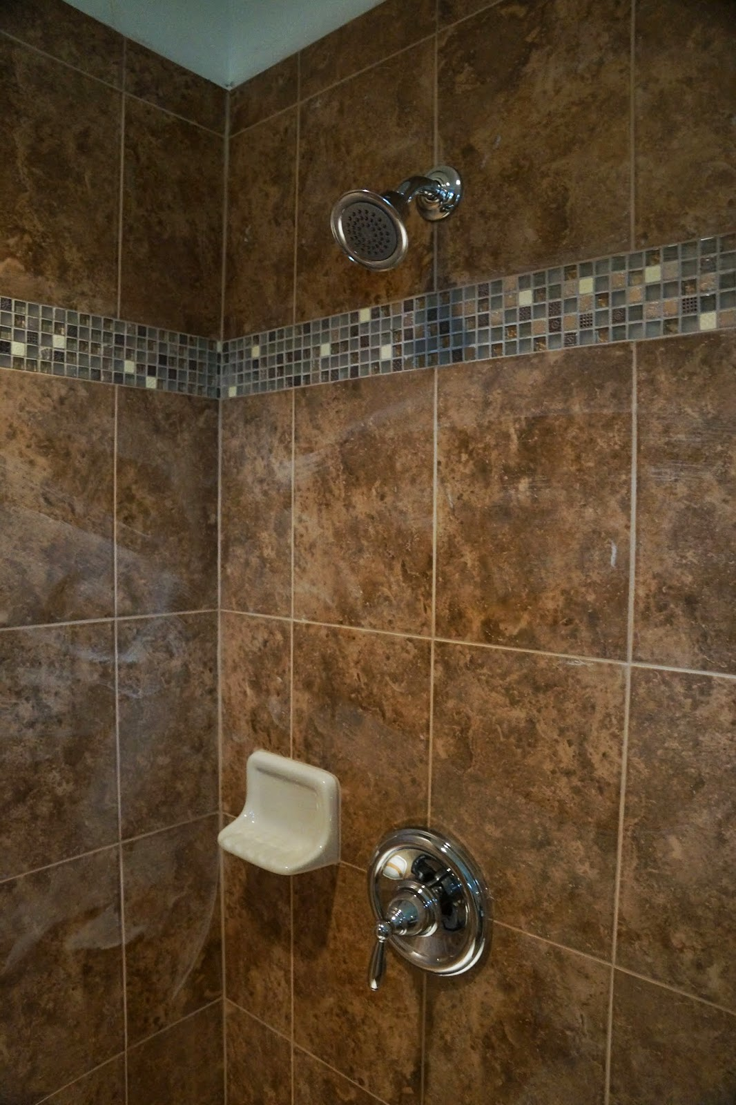 Picture of fixtures in the double shower in the master bathroom.