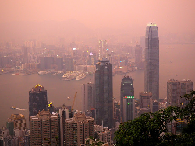 View of Hong Kong, inc. Kowloon & Victoria Harbour, at sunset from The Peak